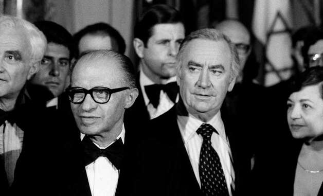 In this May 4, 1978 file photo, Israeli Prime Minister Menachem Begin, center left, and New York Gov. Hugh Carey, center right, attend a reception at New York's Waldorf Astoria Hotel, held to mark the 30th anniversary of the State of Israel. Carey, who led the rescue effort that brought New York City back from the brink of bankruptcy during its 1975 fiscal crisis, died Sunday, Aug. 7, 2011. He was 92. (AP Photo/Ray Stubblebine, File) Photo: Ray Stubblebine / AP1978