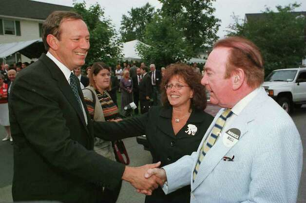 Gov. George Pataki and former Gov. Hugh Carey meet before attending a fundraiser for Monica Bell at her home.  (Times Union Archive) Photo: TOM LAPOINT / ALBANY TIMES UNION