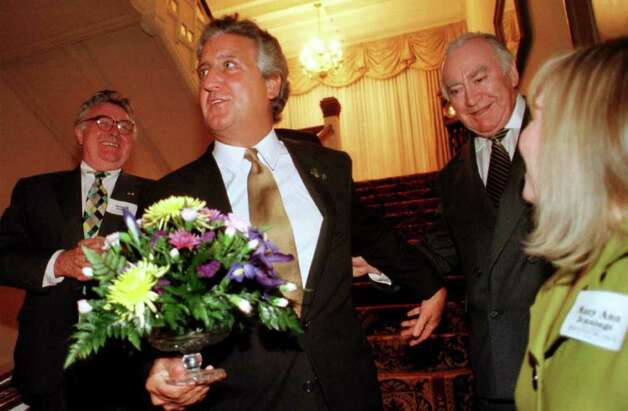 "Mayor Jerry Jennings and his wife, Mary Ann, were presented with a flower arrangement at a patrons reception for ""Highland Cathedral: A Millennium Celebration in honor of Ireland"" prior to the Phil Coulter concert at the Egg on Thursday, March 16, 2000, at the Governors Mansion in Albany, NY. Pictured around the couple is  Joseph Dolan, left, and Co-Chair former Gov. Hugh Carey, right. (Times Union Archive) Photo: STACEY LAUREN / ALBANY TIMES UNION"