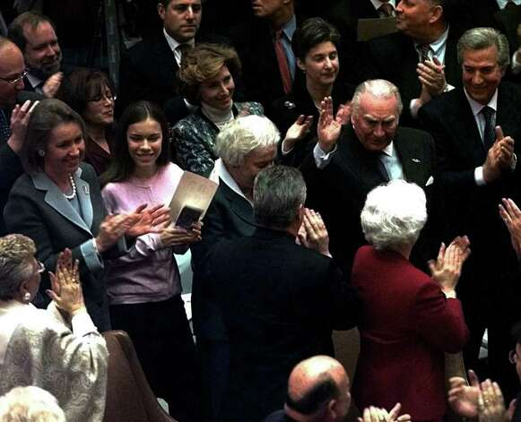 Former Gov. Hugh Carey, right, waves to the crowd in the Assembly Chamber during the State of the State address on  Wednesday, January 3, 2001. At left is Gov. George Pataki's wife, Libby Pataki, and daughter. Pataki's mother sits next to Carey. (Times Union Archive) Photo: STEVE JACOBS / ALBANY TIMES UNION