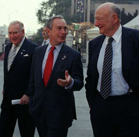 Former New York Gov. Hugh Carey, left, and former New York City Mayor Ed Koch walk with Republican mayoral candidate Michael Bloomberg Thursday, Nov. 1, 2001, to a press conference outside New York's City Hall. The two former elected officials crossed party lines to announce their support of Bloomberg. (AP Photo/Marty Lederhandler) Photo: MARTY LEDERHANDLER / AP