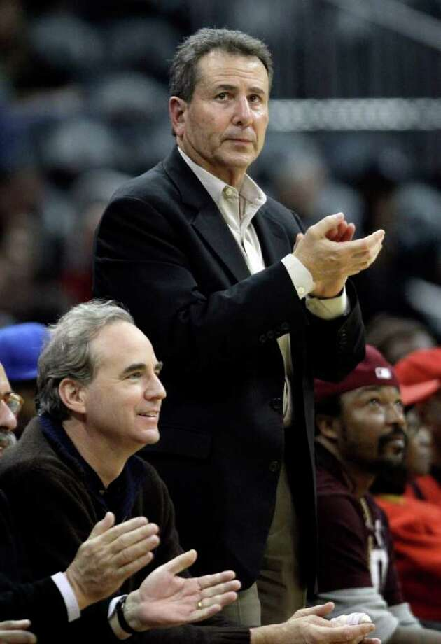 FILE - In this Dec. 22, 2010 file photo, Atlanta Hawks owners Michael Gearon Jr., left, and Bruce Levenson attend an NBA basketball game between the Hawks and the Cleveland Cavaliers in Atlanta. The Hawks and Philips Arena will be sold to California developer and pizza chain owner Alex Meruelo, but the NBA team will remain in Atlanta, a person familiar with the deal said Sunday, Aug. 7, 2011. The Hawks ownership group, led by Gearon Jr. and Levenson, also recently sold the NHL Atlanta Thrashers to a group that has moved the team to Winnipeg. The Thrashers deal, for a reported $170 million, was announced on May 31. (AP Photo/David Goldman, File) Photo: David Goldman, STF / AP2010