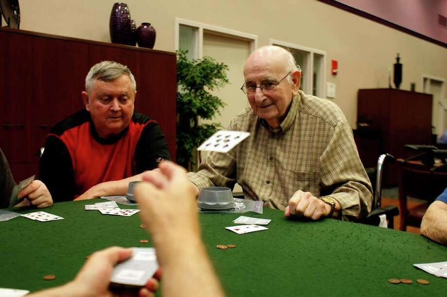 Next to Glenn Huebschmann, 67, (left), Meyer Lewis, 83, (right) waits for his next card as they played a game of seven-card stud poker at Seven Acres Jewish Senior Care Services Tuesday, August 04, 2011, in Houston.  It is Texas' demographic destiny for Latinos to make up more than half the population by 2030. People like Lewis who have lived their life in an Anglo majority are now seeing a change to a minority-majority.  ( Johnny Hanson / Houston Chronicle ) Photo: Johnny Hanson, Staff / © 2011 Houston Chronicle