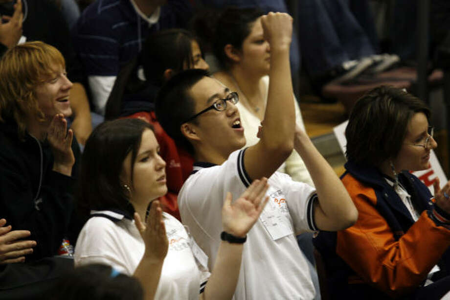 Students from Seven Lakes High School cheer teammates at the Academic Decathlon on Saturday. The school will help represent medium-sized campuses at the state meet. Photo: Johnny Hanson, For The Chronicle
