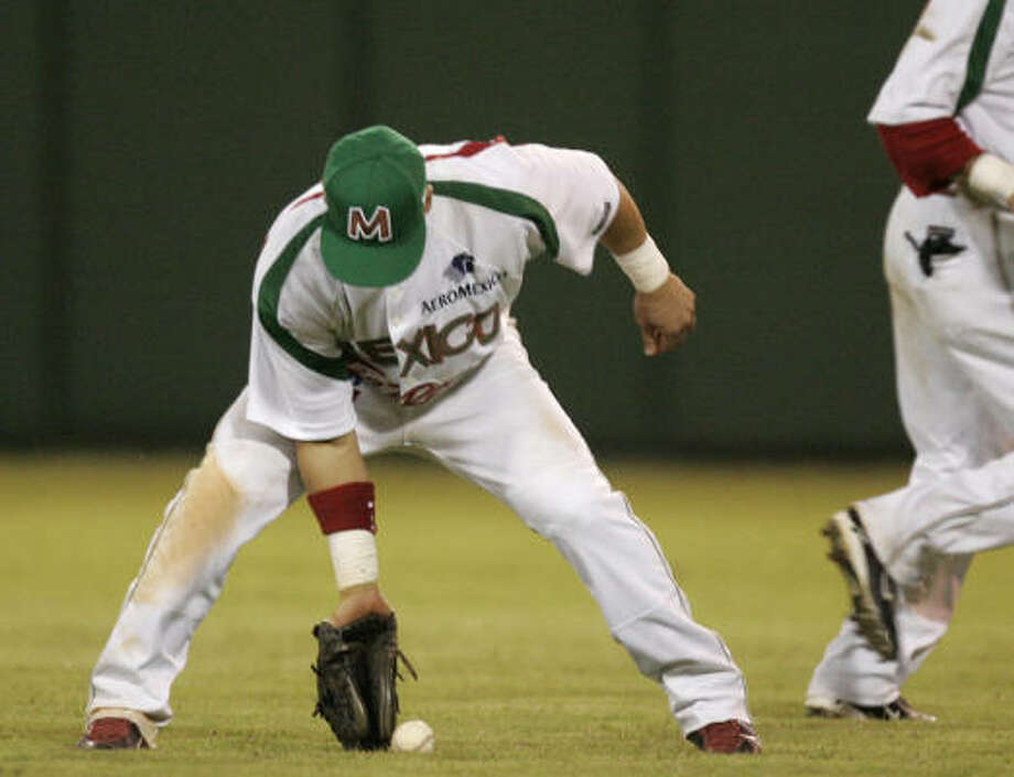 Armando Rios flubs a play for Mexico's Yaquis. Photo: Gregory Bull, AP