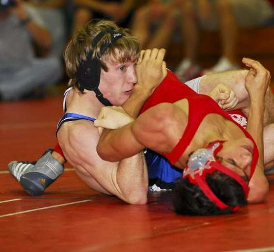 Katy Taylor's Kyle Brown dominated Armando Perez of Katy in the 125-pound final in District 22 action. Here he earns back points before a pin. Photo: Terry Carter, For The Chronicle