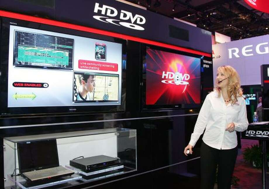 Toshiba's Lori Leland demonstrates HD DVD Web capability at the 2008 consumer electronics show in Las Vegas in January. Toshiba has given up on the technology, ending a format war with Sony's Blu-ray. Photo: ETHAN MILLER, GETTY IMAGES