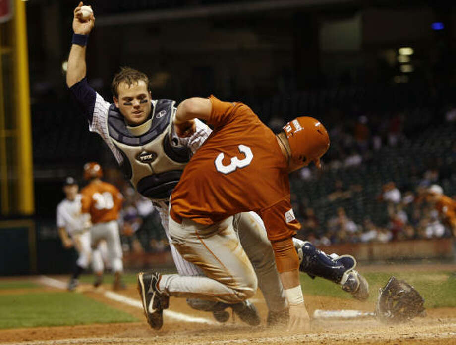 Rice catcher Adam Zornes tags out Texas catcher Cameron Rupp on a failed sacrifice bunt in the fourth inning. Photo: Brett Coomer, Chronicle