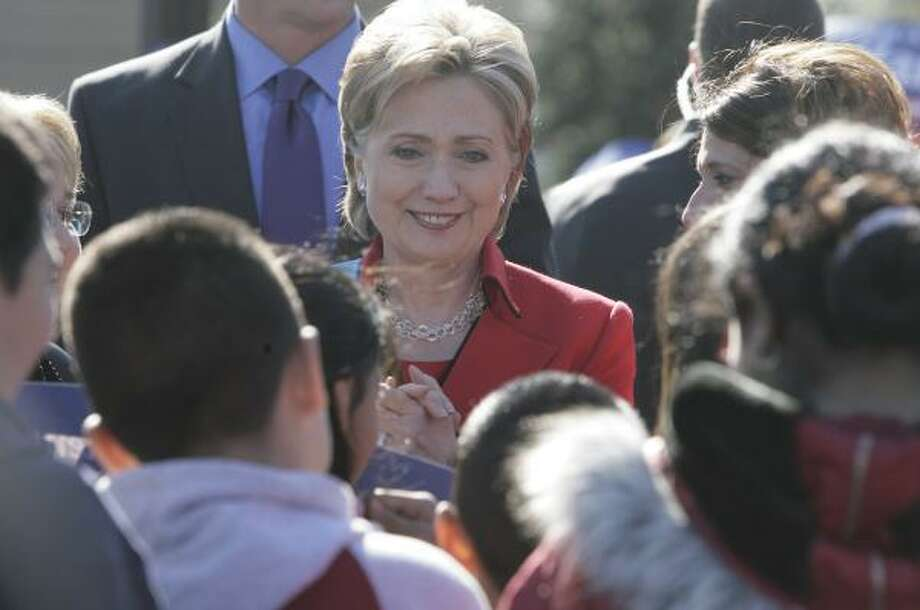 Sen. Hillary Rodham Clinton greets children Tuesday at Houston's J.P. Henderson Elementary before heading to Dallas. Photo: JULIO CORTEZ, CHRONICLE