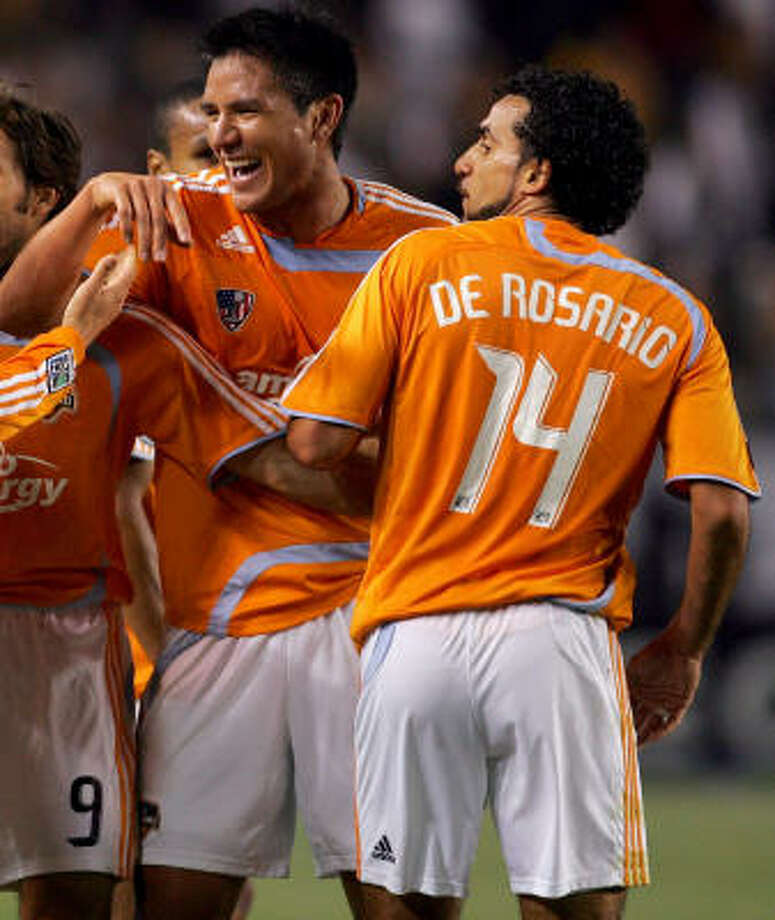 Houston Dynamo's Brian Ching and Dwayne De Rosario should get out their slumps, according to previous seasons. Photo: Victor Decolongon, Getty Images