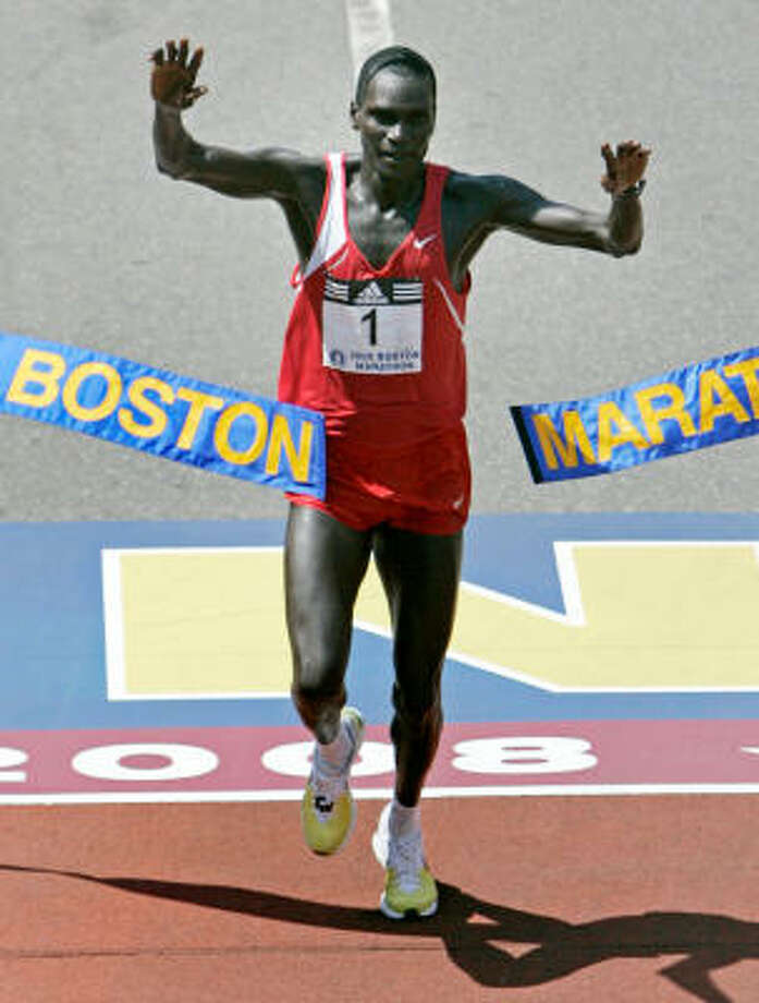 Robert Cheruiyot of Kenya raises his arms as he breaks the tape to win the Boston Marathon in Boston on Monday. Photo: Charles Krupa, AP