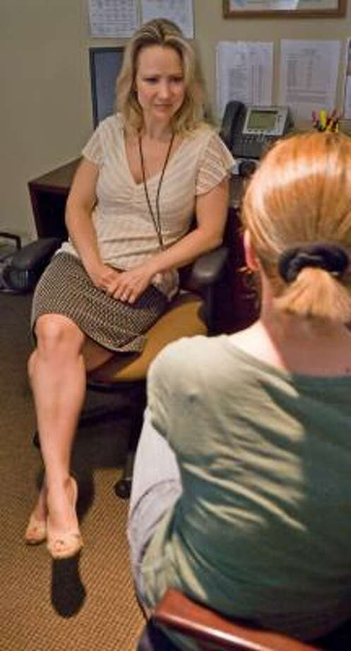 Clinical psychologist Angela Redlak talks with a patient at Renfrew Center Foundation in Charlotte, N.C. Photo: GARY O'BRIEN, CHARLOTTE OBSERVER