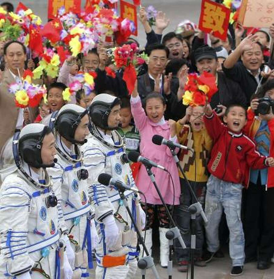 Chinese astronauts Jing Haipeng, far left, Zhai Zhigang and Liu Boming attend a ceremony before the launch of the Shenzhou 7 at the Jiuquan Satellite Launch Center on Thursday. Photo: COLOR CHINA, ASSOCIATED PRESS