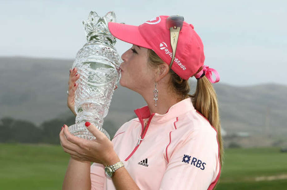 Paula Creamer poses with the trophy on the 18th hole after winning during the final round of the Samsung World Championship. Photo: Jonathan Ferrey, Getty Images