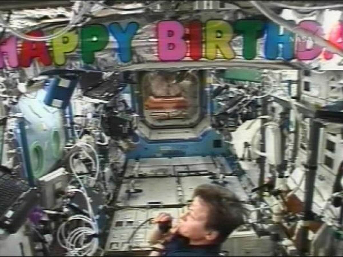 In this image taken from video provided by NASA TV, station commander Peggy Whitson speaks to ground controllers while marking her 48th birthday in space on Saturday.