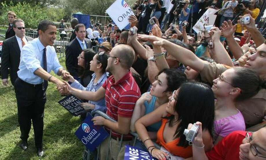Sen. Barack Obama delights supporters Friday as he pitches his campaign themes to students at the University of Texas-Pan American. He later attended a larger rally in Austin. Photo: RICK BOWMER, ASSOCIATED PRESS