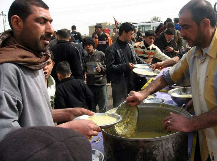 Volunteers serve lentil soup to pilgrims as they make the trek to the holy city of Karbala and commemorate the Arbaeen, the anniversary of the 40th day after Imam Hussein's death. Hussein was the grandson of the Prophet Muhammad. Photo: HUSSEIN KADHIM, MCT