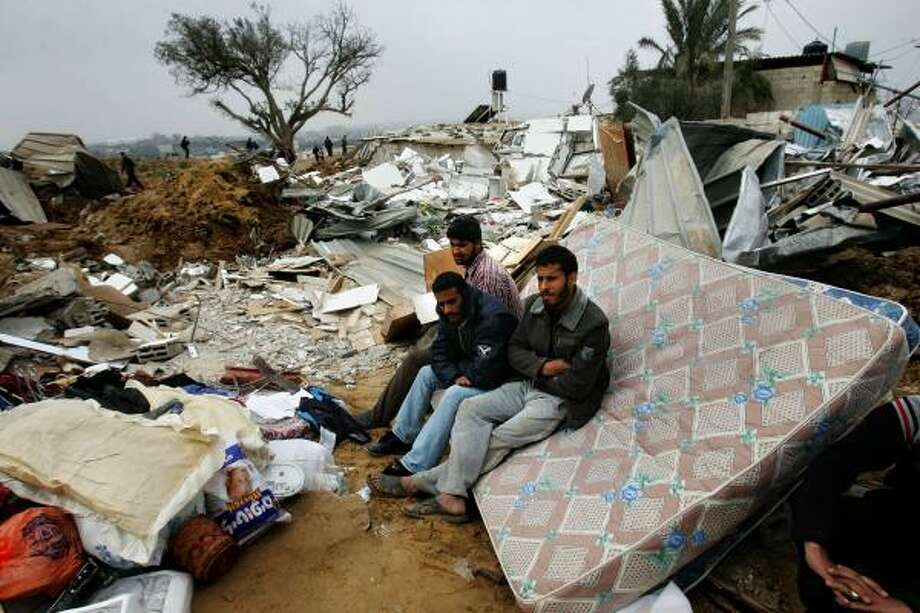 Palestinians sit on the rubble of their home after it was destroyed by Israeli bulldozers Monday. The two-day Israeli incursion into Gaza caused widespread unrest in the Fatah-controlled West Bank. Photo: ABID KATIB, GETTY IMAGES