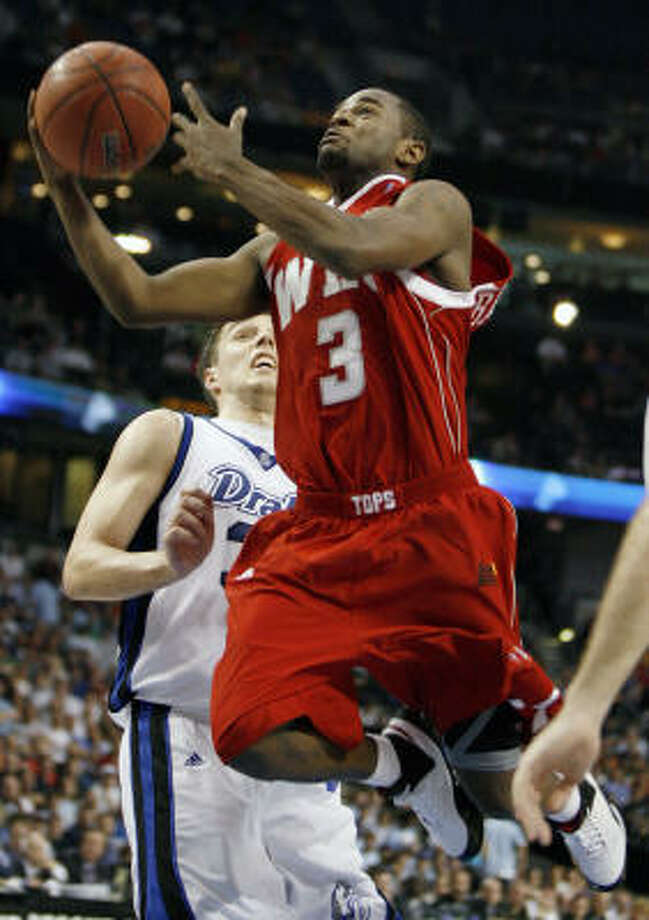 Tyrone Brazelton scored a game-high 33 points for Western Kentucky in the Tournamen's first 5-12 upset. Photo: Mike Carlson, AP