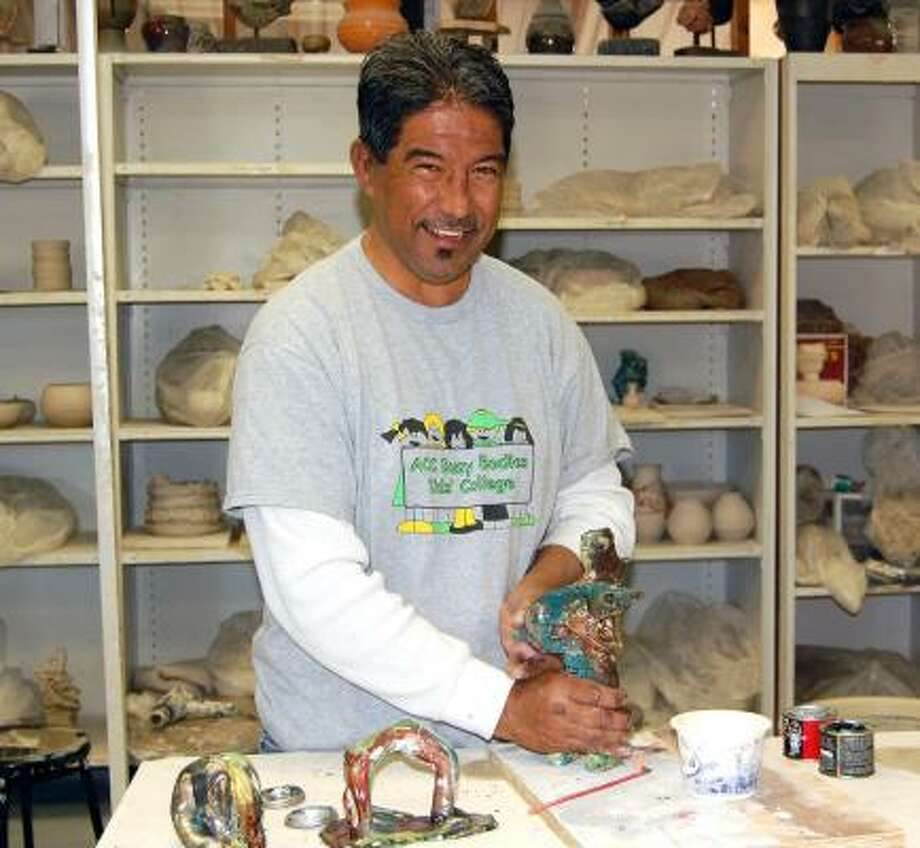 Frank Medel works at the pottery studio at Alvin Community College. Photo: WENDY RUDNICKI, FOR THE CHRONICLE