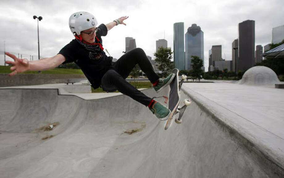 Ben Raybourn skates in the expert bowl of the Lee and Joe Jamail Skatepark. The park, which opens at 1 p.m. today, offers all levels of skaters something fun to do. Photo: Kevin Fujii, Chronicle