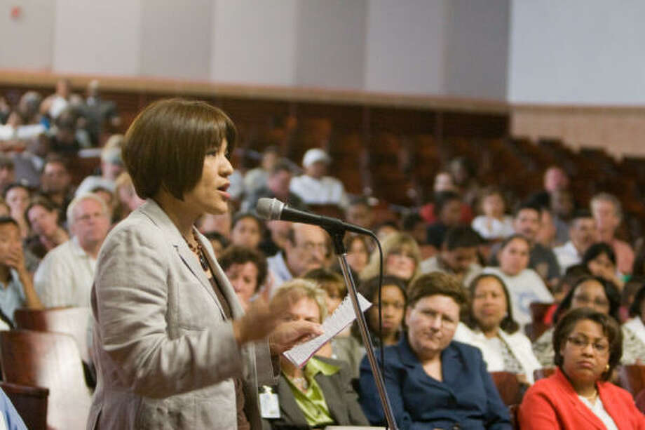 Wharton ES Community Representative Sonia Corrales speaks at an HISD public meeting at Ezekiel Cullen Middle School to discuss school closings and consolidations. Photo: R. Clayton McKee, For The Chronicle