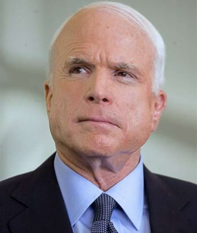Evangelical support for GOP hopeful John McCain may be motivated out of opposition to Barack Obama. Photo: ALFREDO ESTRELLA, AFP/GETTY IMAGES