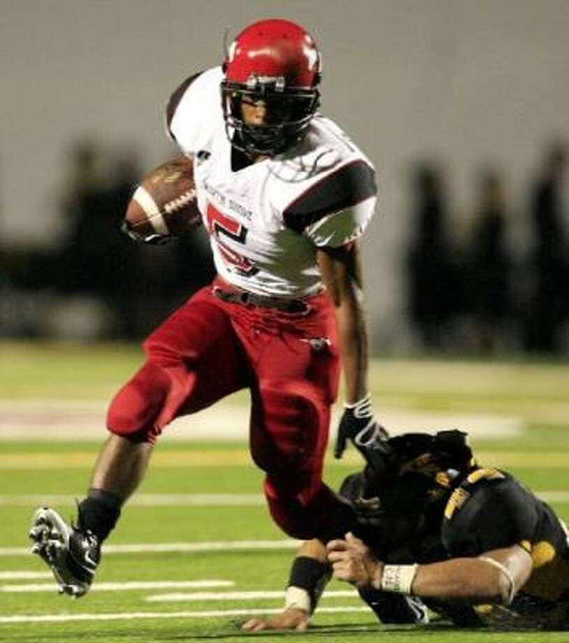 North Shore running back Deaundre Jones (5) makes a run against Eisenhower in the second quarter of Friday night's game. Photo: Eric Kayne, Chronicle