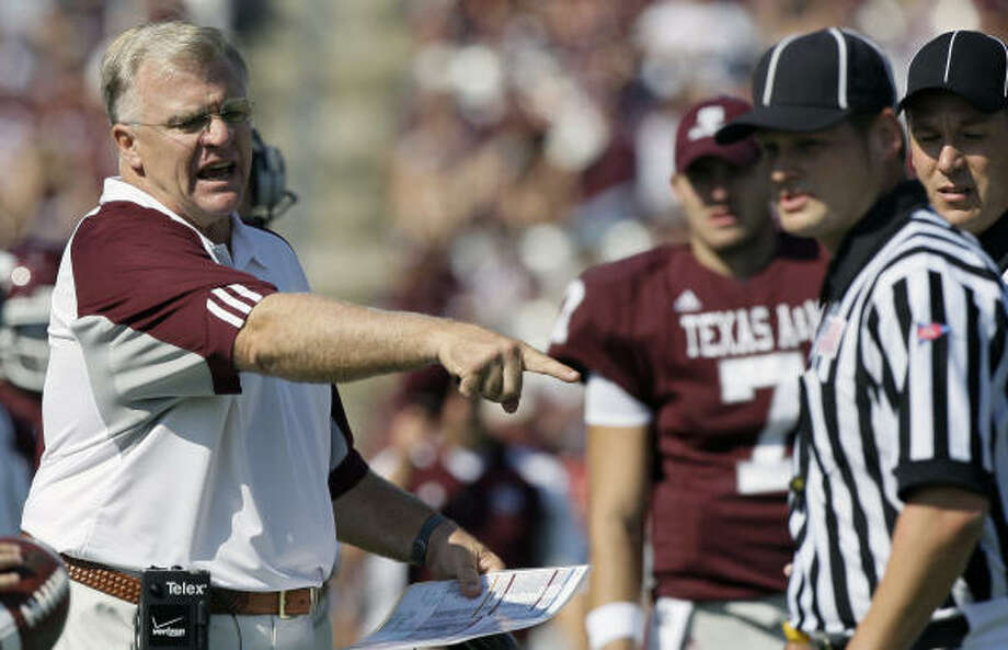 A&M coach Mike Sherman, left, had reason to be upset until the third quarter when the Aggies scored 21 points. Photo: David J. Phillip, AP