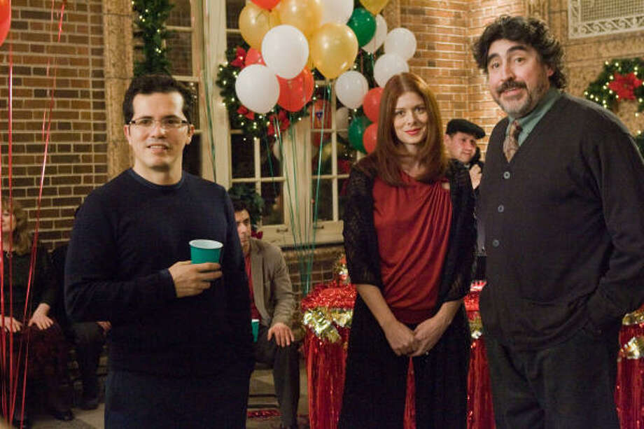 John Leguizamo, left, Debra Messing and Alfred Molina star in the holiday dramedy Nothing Like the Holidays. Photo: Overture Films