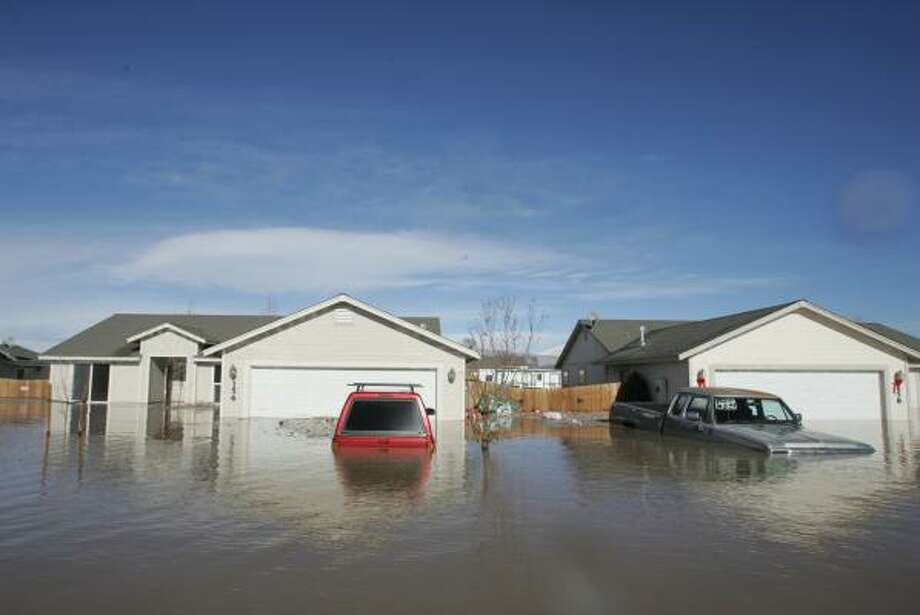 Homes in Fernley, Nev., sits in floodwaters on Saturday after a canal levee ruptured from heavy rainfall, pouring more than 3 feet of near-freezing water into hundreds of homes and stranding 3,500 people in their desert agricultural town Photo: BRAD HORN, AP