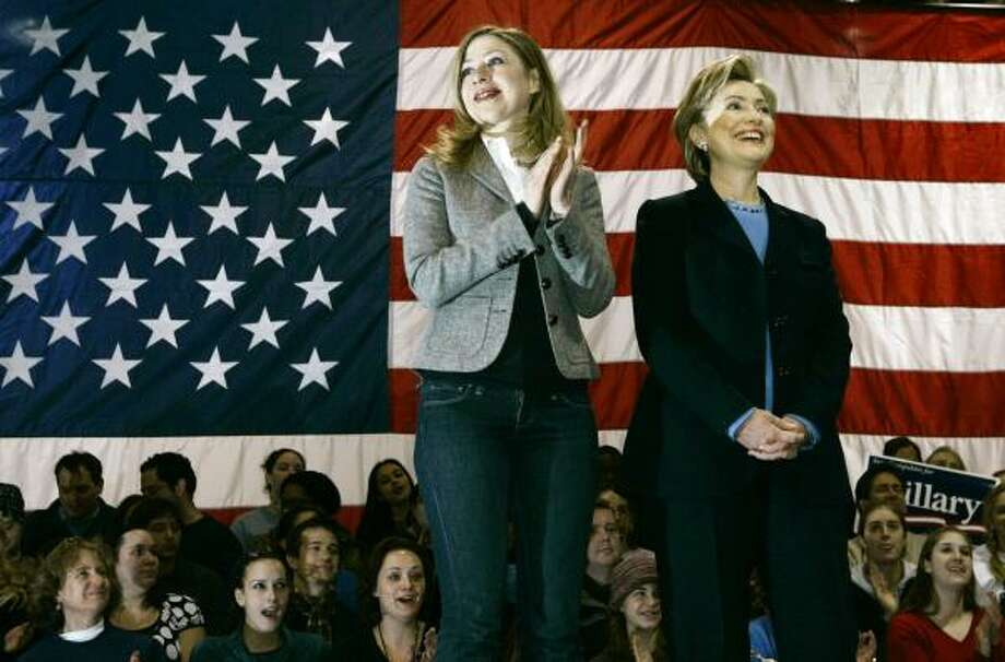 Democratic presidential hopeful Hillary Clinton and daughter Chelsea acknowledge the crowd Saturday in Penacook, N.H. Photo: ELISE AMENDOLA, ASSOCIATED PRESS