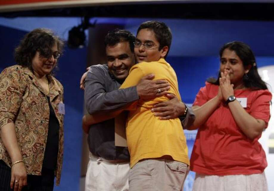 "Sameer Mishra, in yellow shirt, of Lafayette, Ind., celebrates with his family after correctly spelling ""guerdon"" to win the 2008 Scripps Howard Spelling Bee. Photo: CHUCK KENNEDY, MCCLATCHY NEWS SERVICE"