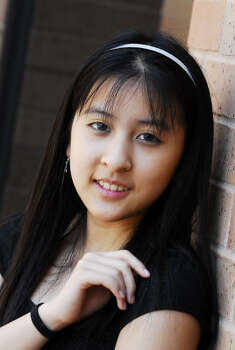 Cy Falls Christy Nguyen, 16, graduates at top of class