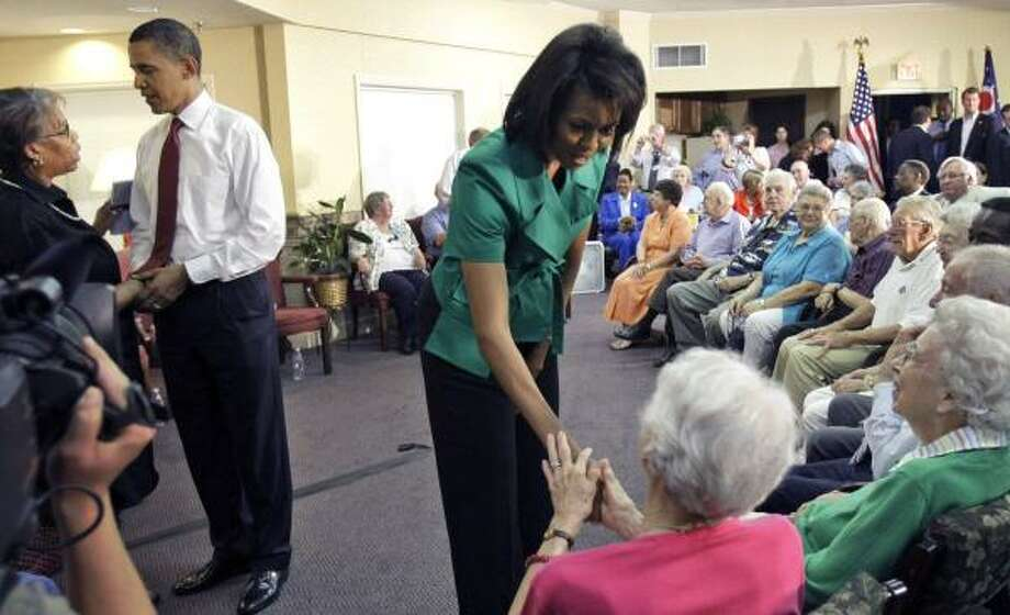 Democratic presidential candidate Barack Obama and his wife, Michelle, talk about Social Security with residents at Oakleaf Village retirement community Friday in Columbus, Ohio. Photo: ALEX BRANDON, ASSOCIATED PRESS