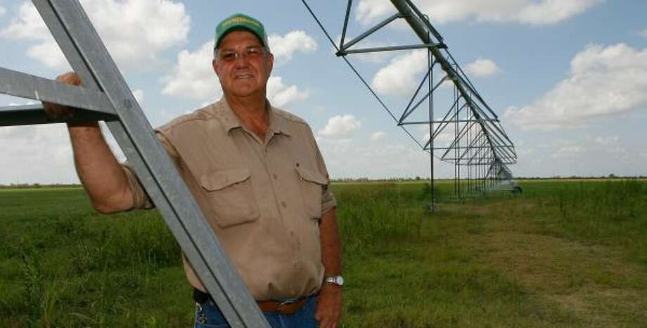 Tom Paben has used irrigation to water his crops, but a severe drought has nevertheless ruined many acres of corn. He says he intends to slash his crop acreage and turn to livestock as his primary source of income on his Waller farm. Photo: STEVE CAMPBELL, CHRONICLE