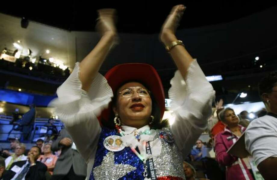 Texas delegate Lillian Villarreal applauds as the roll call is made to nominate Barack Obama on Wednesday at the Democratic National Convention. Villarreal, a 54-year-old executive assistant who once worked for Enron, had voted for Clinton by paper during the morning at her hotel. Photo: LACY ATKINS, SAN FRANCISCO CHRONICLE