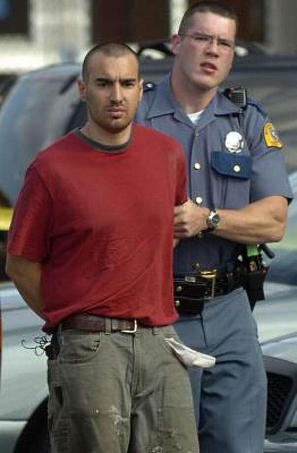 Isaac Zamora is led to jail Tuesday in Washington. Photo: SCOTT TERRELL, SKAGIT VALLEY HERALD