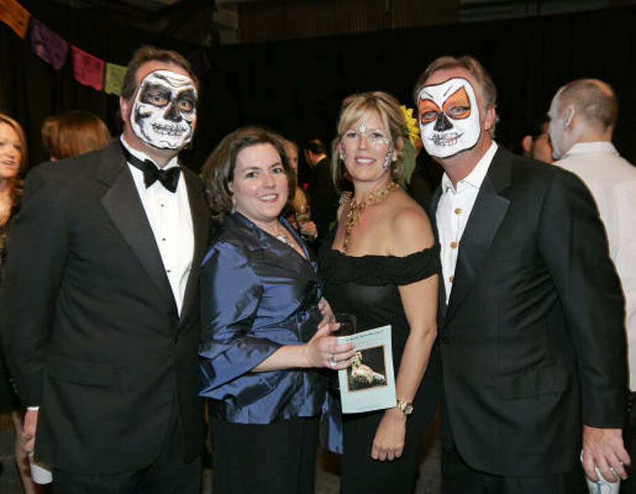Reece and Allison Boudreaux, from left, joined Orange Show gala chairs Paige and Todd Johnson in black-tie spookiness. Photo: Craig Hartley, For The Chronicle