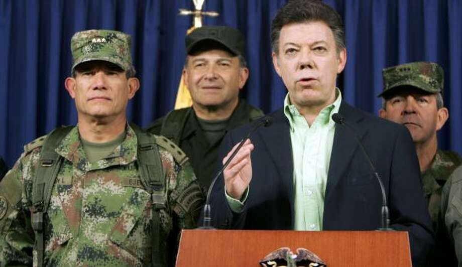 Colombian Defense Minister Juan Manuel Santos holds a news conference Saturday to announce that Raul Reyes, a guerrilla commander, has been killed in a joint military and national police operation. Reyes was killed in an airstrike near the Ecuadoran border. Photo: MAURICIO DUENAS, AFP/GETTY IMAGES