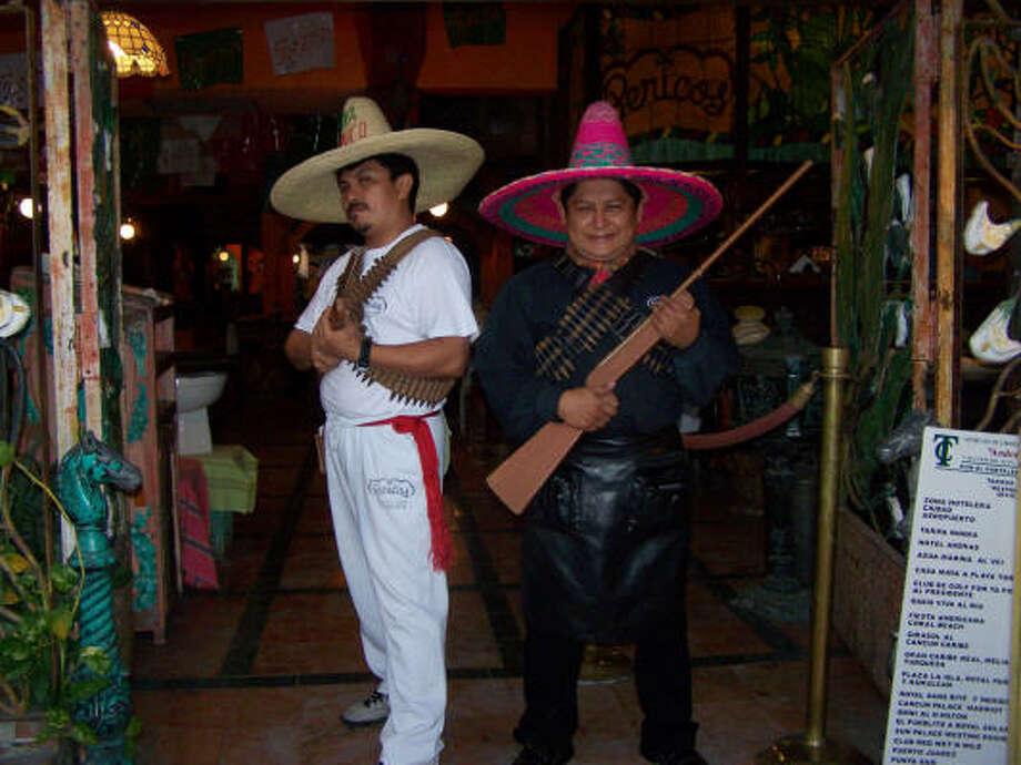 Waiters Venucio Aguilar and Egildio Ek ham it up at the entrance to Pericos. Photo: John Bordsen, Charlotte Observer