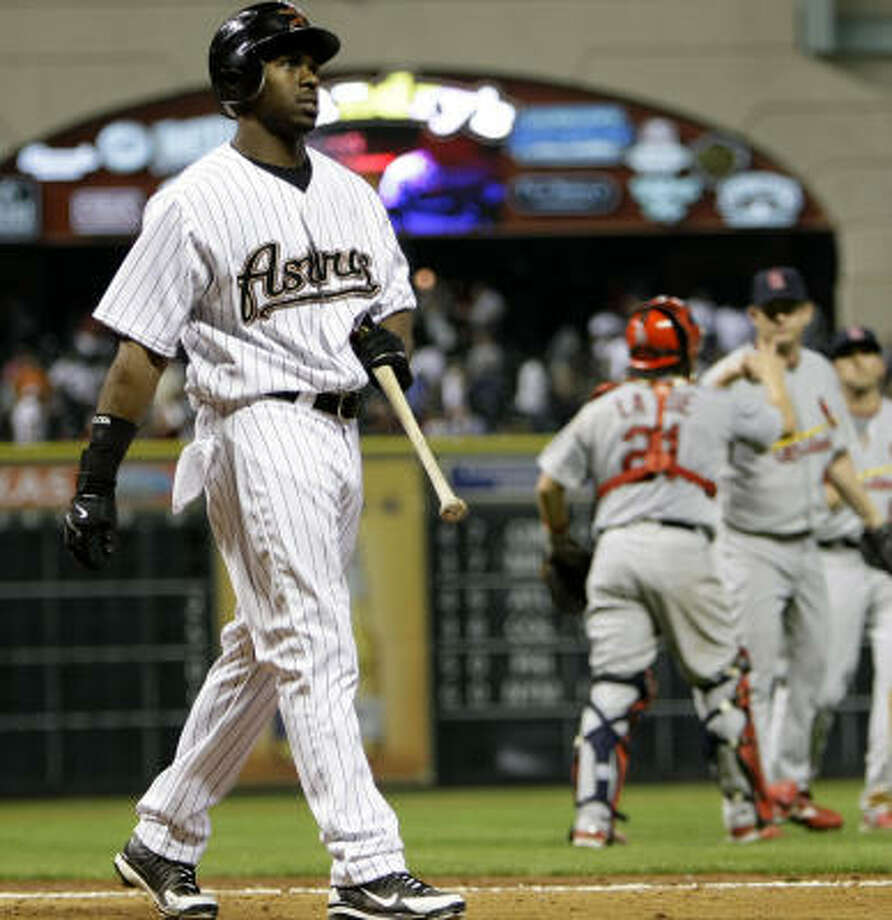 Michael Bourn walks back to the dugout after striking out in the 9th inning to end the game against the Cardinals on April 8. Photo: Karen Warren, Houston Chronicle