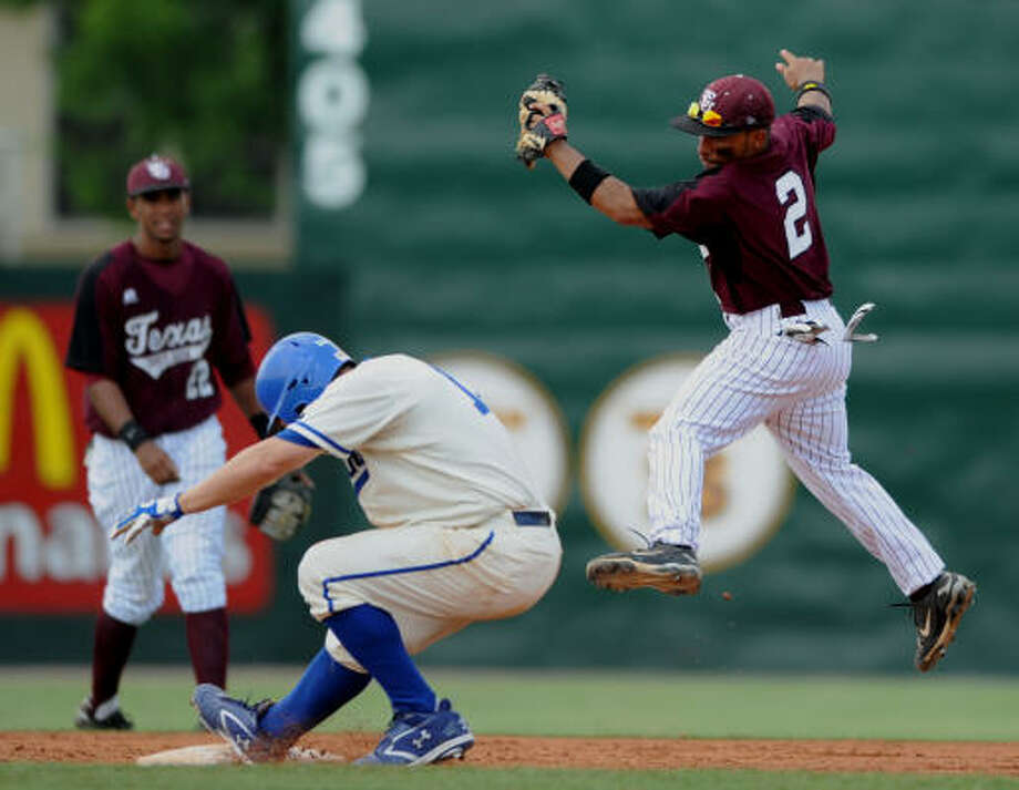 New Orleans' Jay Morris, center, safely makes it to second base as TSU's Michael Norris, right, catches the throw. Photo: Mark Saltz, AP
