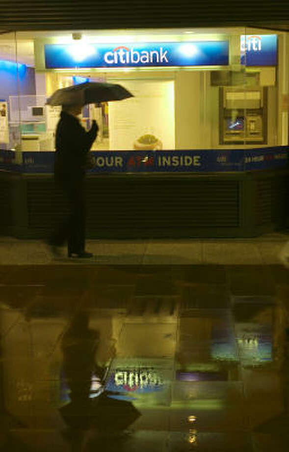 A pedestrian walks past a branch of Citigroup bank in London. Photo: SANG TAN, Associated Press