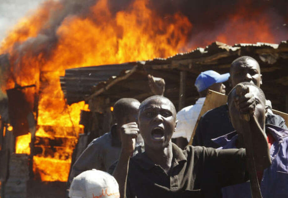 Residents of the Mathare slum in Nairobi shout at demonstrators during clashes between two rival groups today. Photo: TONY KARUMBA, AFP/Getty Images