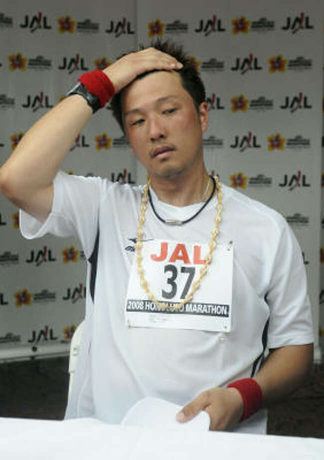 Red Sox pithcer Hideki Okajima competed in the marathon and took nearly three hours to reach the midpoint. Photo: Ronen Zilberman, AP