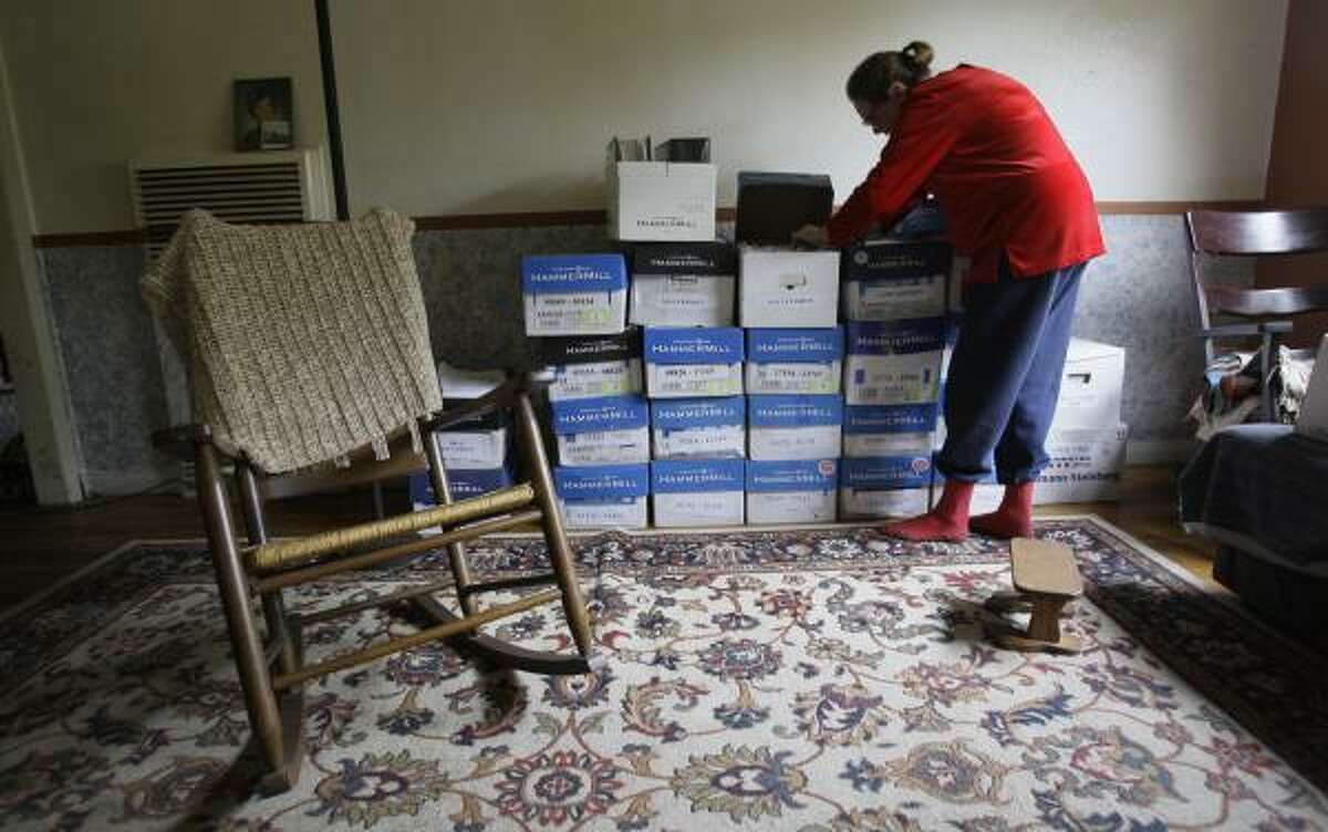 Prompted by a suspicious repair estimate for her Oak Forest home in 2002, Farmer compiled documents that eventually helped expose problems in the home repair program.