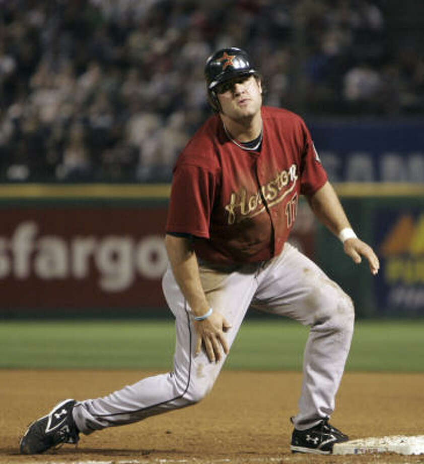 While there's a tiny chance Astros slugger Lance Berkman (shown Friday) will become the first Triple Crown winner since 1967, there's a very good chance there will be a summer full of conversations about one of baseball's most elusive feats, columnist Zachary Levine writes. Photo: LM Otero, AP