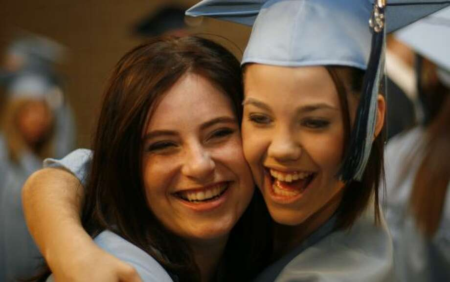 Shelby Puckett, left, and Ashlei Ives of Kingwood High School prepare for their commencement ceremony Saturday. Photo: LEONARDO CARRIZO, CHRONICLE