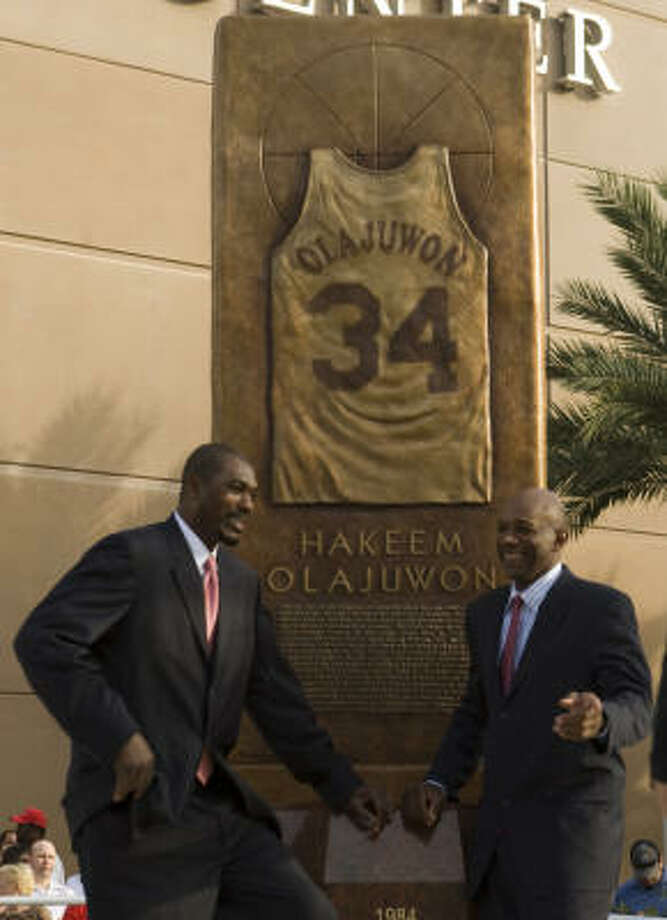 Clyde Drexler, right, joins Hakeem Olajuwon for the unveiling of a tribute at Toyota Center in April. Photo: Brett Coomer, Chronicle
